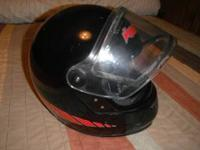 This is a black Vector snowmobile helmet. It is used
