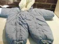 This item is a girls snowsuit, size 6 to 9 months, and