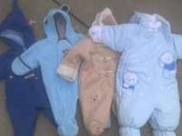 4 snowsuits never worn. Perfect condition. 2 of them