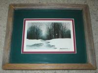 This art print is of a snowy wintery water stream. It