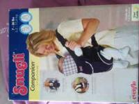 VERY GENTLY USED SNUGLI BABY CARRIER ONLY ASKING $5!!!