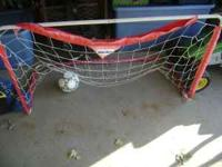 Soccer net and ball. Used and net is ripped a bit. A