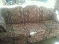 Floral Pattern Used Sofa. Good Shape. One small hole on
