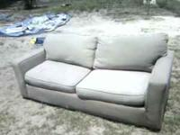 A TAN CLOTH SOFA IN GOOD CONDITION AT A REASONABLE