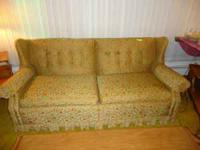 Brown and Orange Sofa in great condition 75.00 obo call