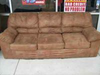 Pre-leased Ashley sofa only Buddys Home Furnishings 101