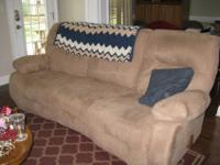 Tan in color, microfiber sofa is 3 cushion with