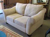 Neutral light beige sofa and love seat. Great