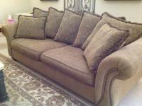 Matching sofa and love seat for sale. Couch is approx