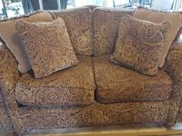 Gold, Burgundy and Brown paisley print tapestry.  Sofa