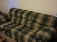 Green and brown sofa and love seat. The love seat comes