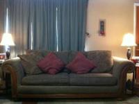 Brown sofa and loveseat with wood trim, also fabric is