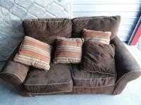 Matching dark brown sofa and loveseat with off-white