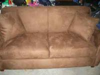 Sofa bed in like new condition. It is 1 year old. We