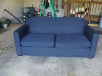 Blue sofa - some damage to the upholstery on the arms.