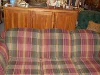 THIS SOFA BY BROYHILL COVERED IN A PLAID FABRIC NO