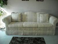 SOFA, CAMELBACK WITH HIGH ROLL ARMS, CREAM COLORED