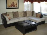 Like new Sofa with Chase and Ottoman. Ottoman tops are