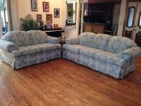 Smokey blue matching couch and loveseat, barely used in