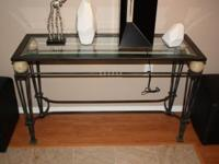 Sofa table -- stylish table features: a wrought iron
