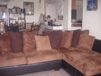 L shaped sofa with three matching coffee tables brand