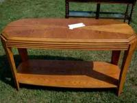 This oak colored sofa table can be used in your living