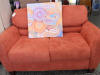 We have this very nice burnt orange two seat sofa in