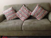 The beautiful light green three seater comfy sofa set