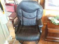 Very nice soft leather chair. It has a round base and