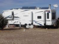 Solar 2011 38 ft Bighorn 5th wheel 3670 for sale. Has 8