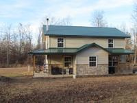 "SOLAR POWERED ""OFF GRID"" 2 STORY HOME, 40 ACRES, POND."