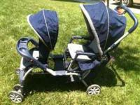 Evenflo double stroller. Has canopy for shade and large