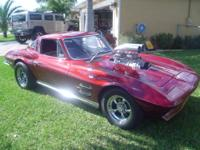 You are looking at a Red Hot 1964 Chevrolet Corvette