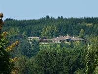 Welcome High atop a hill on 11 acres in beautiful West
