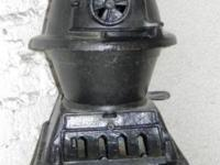 Solid cast iron pot bellied stove; No rust. Was used