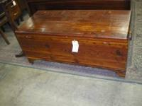 This beautiful solid cedar blanket chest features a