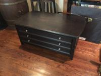 Solid coffee table in great condition-stands up to