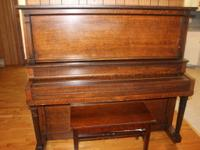 Beautiful solid oak upright piano for sale. Was used in