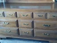 I am selling a solid dark wood TV armoire. It has two