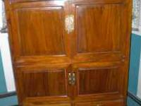 I'm selling a beautiful solid elmwood alter cabinet