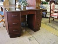 This solid mahogany desk is an antique and in great