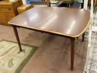 This is a nice solid mahogany dining room table. It is