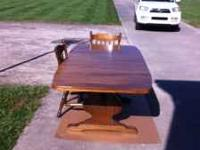 "Solid mahogany table with 2 - 12"" leafs and 8 chairs."
