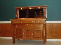This piece is solid maple with cathedral drawers. I