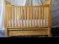 55 X 30 Solid maple wood crib. It is in near perfect