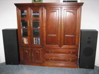 Beautiful maple wood entertainment center in