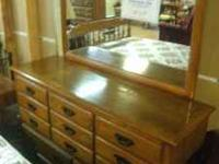 For sale we have a 4 pc Solid Oak bedroom set by Link &