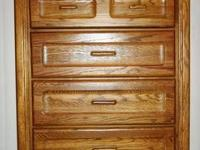 Up for sale is a solid oak brown dresser with a