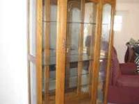 Nice oak curio cabinet has three glass shelves...has a