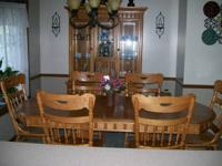 We are selling our Ashley Oak dining room set. This set